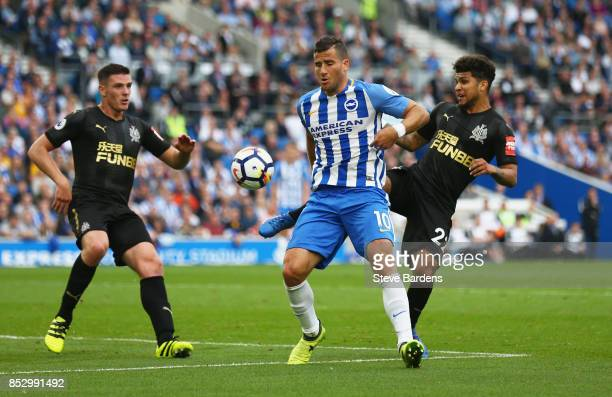 Tomer Hemed of Brighton and Hove Albion holds off DeAndre Yedlin of Newcastle United during the Premier League match between Brighton and Hove Albion...
