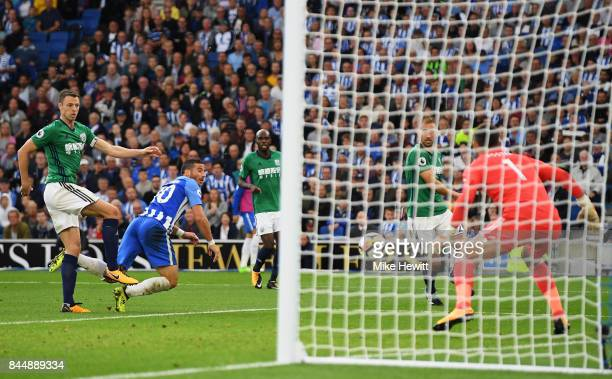Tomer Hemed of Brighton and Hove Albion scores his sides third goal during the Premier League match between Brighton and Hove Albion and West...