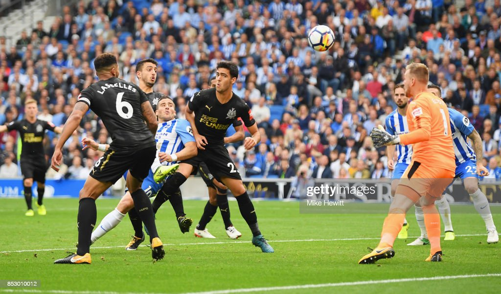 Tomer Hemed of Brighton and Hove Albion (C) scores their first goal past Robert Elliot of Newcastle United during the Premier League match between Brighton and Hove Albion and Newcastle United at Amex Stadium on September 24, 2017 in Brighton, England.