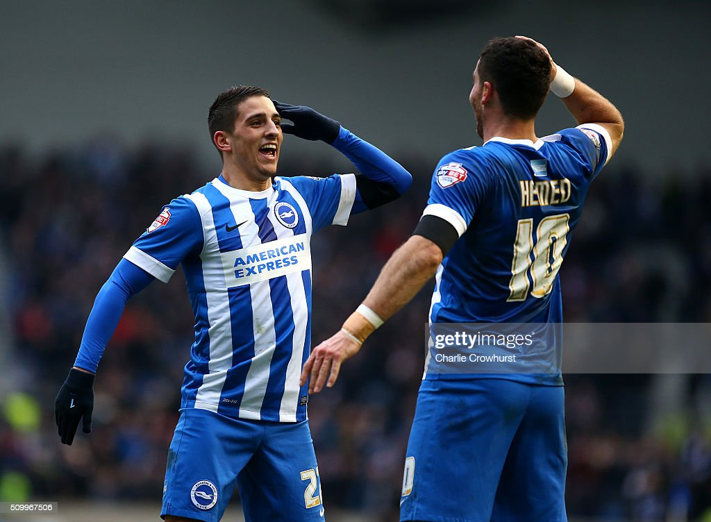 Tomer Hemed of Brighton celebrates with team mate Anthony Knockhaert who assisted him after he scores the teams second goal during the Sky Bet...