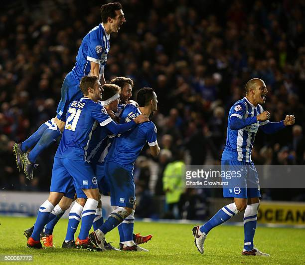 Tomer Hemed of Brighton celebrates with team mates after scoring the teams third and winning goal of the game during the Sky Bet Championship match...