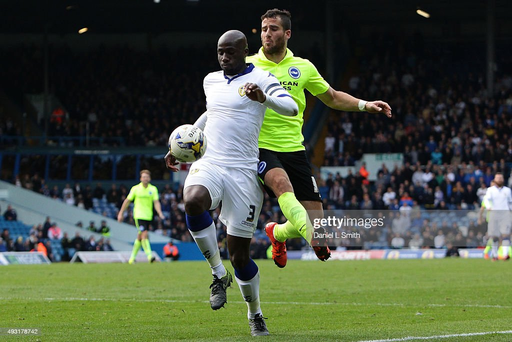 Tomer Hemed of Brighton Hove Albion FC jumps on the back of Souleman Bamba of Leeds United FC during the Sky Bet Championship match between Leeds...
