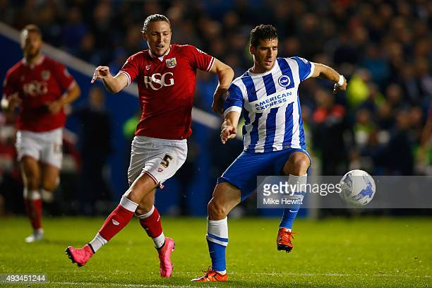 Tomer Hemed of Brighton is challenged by Luke Ayling of Bristol City during the Sky Bet Championship match between Brighton Hove Albion and Bristol...