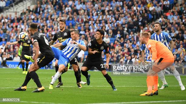 Tomer Hemed of Brighton scores the only goal of the game during the Premier League match between Brighton and Hove Albion and Newcastle United at...