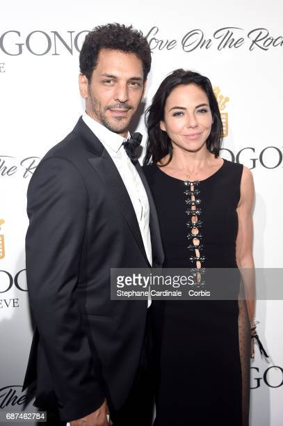 Tomer Sisley and Sandra Zeitoun attend DeGrisogono 'Love On The Rocks' during the 70th annual Cannes Film Festival at Hotel du CapEdenRoc on May 23...