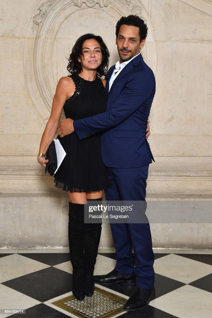 Tomer Sisley and Sandra Zeitoun attend the Christian Dior show as part of the Paris Fashion Week Womenswear Spring/Summer 2018 on September 26, 2017 in Paris, France.