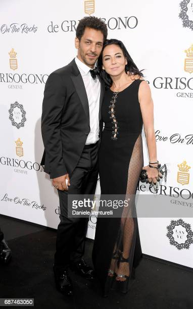 Tomer Sisley and Sandra Zeitoun attend the De Grisogono 'Love On The Rocks' party during the 70th annual Cannes Film Festival at Hotel du CapEdenRoc...