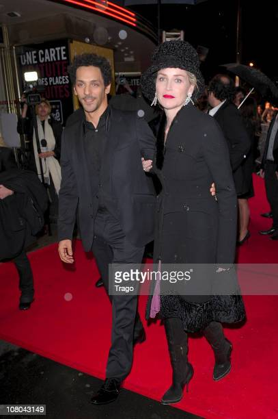 Tomer Sisley and Sharon Stone arrive at the Paris Premiere for 'Largo Winch II' Premiere Paris France