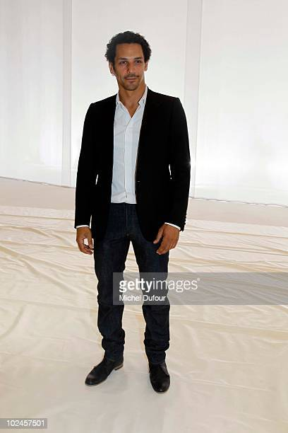 Tomer Sisley attends the Dior Homme show as part of Paris Menswear Fashion Week Spring/Summer 2011 at Halle Freyssinet on June 26 2010 in Paris France