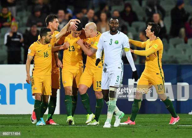 Tomi Juric Aaron Mooy and Tomas Rogic of Australia celebrate after scoring a goal during the 2018 FIFA World Cup Qualifier match between the...