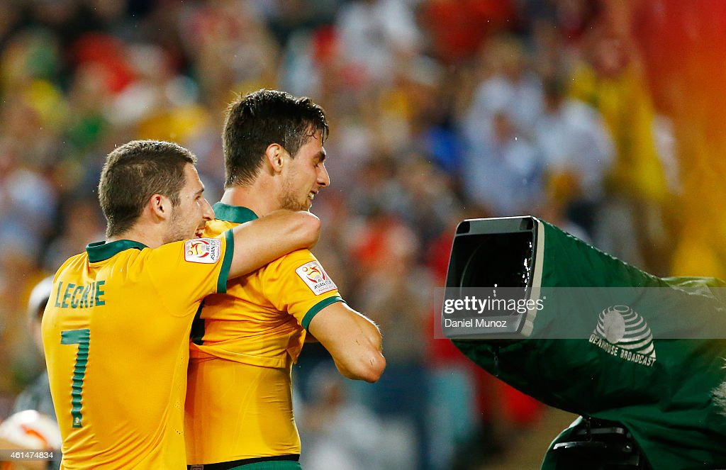 Tomi Juric and Mathew Leckie of Australia celebrate after Juric scored during the 2015 Asian Cup match between Oman and Australia at ANZ Stadium on January 13, 2015 in Sydney, Australia.