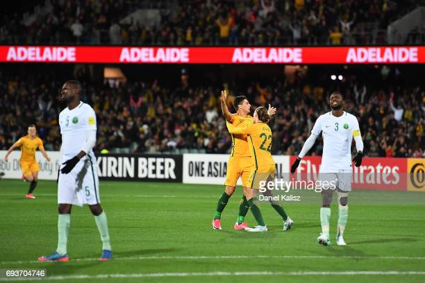 Tomi Juric celebrates with Jackson Irvine of Australia after scoring a goal during the 2018 FIFA World Cup Qualifier match between the Australian...