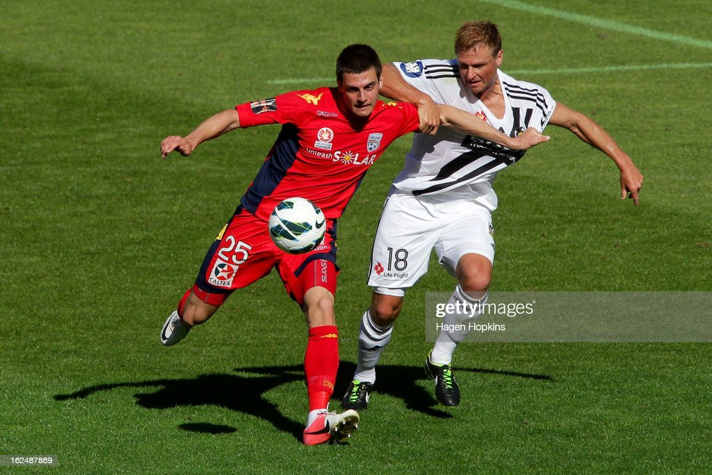Tomi Juric of Adelaide and Ben Sigmund of the Phoenix compete for the ball during the round 22 A-League match between the Wellington Phoenix and Adelaide United at Westpac Stadium on February 24, 2013 in Wellington, New Zealand.