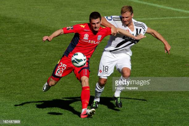 Tomi Juric of Adelaide and Ben Sigmund of the Phoenix compete for the ball during the round 22 ALeague match between the Wellington Phoenix and...