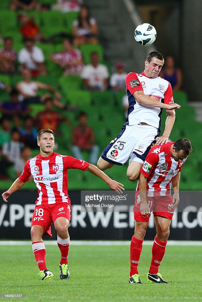 Tomi Juric of Adelaide United jumps for the ball on Richard Garcia of the Heart during the round 24 A-League match between the Melbourne Heart and Adelaide United at AAMI Park on March 11, 2013 in Melbourne, Australia.