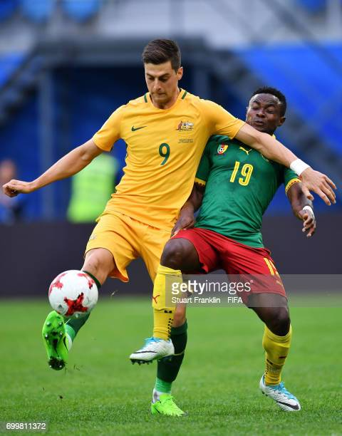 Tomi Juric of Australia and Collins Fai of Cameroon battle for possession during the FIFA Confederations Cup Russia 2017 Group B match between...