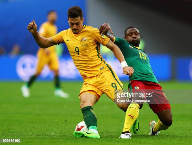 Tomi Juric of Australia and Sebastien Siani of Cameroon battle for possession during the FIFA Confederations Cup Russia 2017 Group B match between...