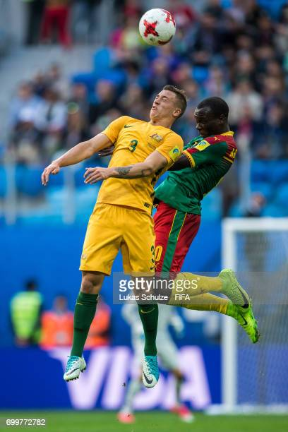 Tomi Juric of Australia and Vincent Aboubakar of Cameroon head the ball during the FIFA Confederations Cup Russia 2017 Group B match between Cameroon...