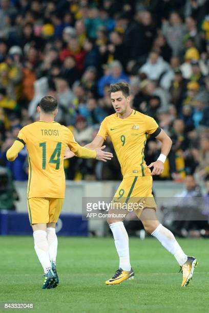 Tomi Juric of Australia celebrates scoring a goal with teammate James Troisi during the World Cup 2018 qualifying football match between Australia...