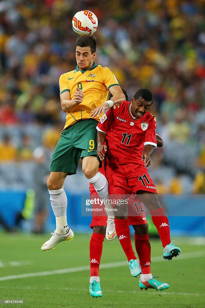 Tomi Juric of Australia competes with Amer Said Al-Shatri of Oman during the 2015 Asian Cup match between Oman and Australia at ANZ Stadium on January 13, 2015 in Sydney, Australia.