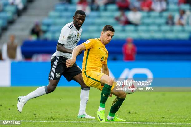 Tomi Juric of Australia competes with Antonio Ruediger of Germany during the FIFA Confederations Cup Russia 2017 group B football match between...
