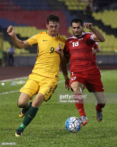 Tomi Juric of Australia is challenged by Zaher Almendani of Syria during the 2018 FIFA World Cup Asian Playoff match between Syria and the Australia...