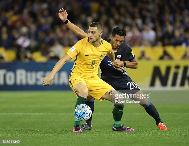 Tomi Juric of Australia is pressured by Tomoaki Makino of Japan during the 2018 FIFA World Cup Qualifier match between the Australian Socceroos and...