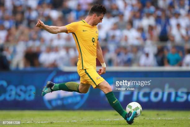 Tomi Juric of Australia kicks the ball during a first leg match between Honduras and Australia as part of FIFA World Cup Qualifiers Play Off at...