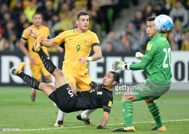 Tomi Juric of Australia looks on after coming under pressure from Adison Premark of Thailand during the World Cup 2018 qualifying football match...