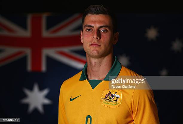 Tomi Juric of Australia poses during an Australian Socceroos headshot session at the InterContinental Hotel on January 3 2015 in Melbourne Australia