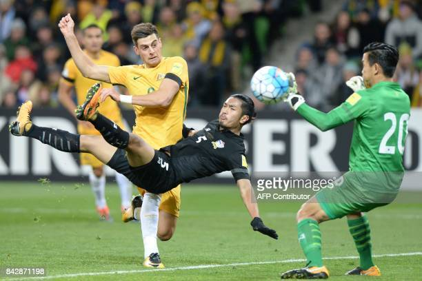 Tomi Juric of Australia reacts after coming under pressure from Adison Premark of Thailand during the World Cup 2018 qualifying football match...