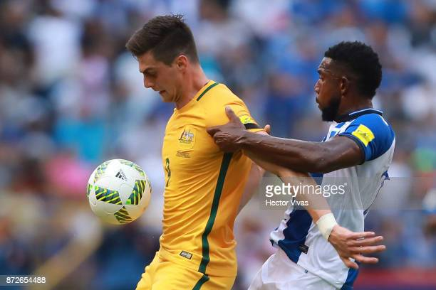 Tomi Juric of Australia struggles for the ball with Johnny Palacios of Honduras during a first leg match between Honduras and Australia as part of...