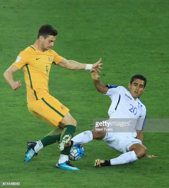 Tomi Juric of Australia tackled by Jorge Claros of Honduras during the 2018 FIFA World Cup Qualifiers Leg 2 match between the Australian Socceroos...
