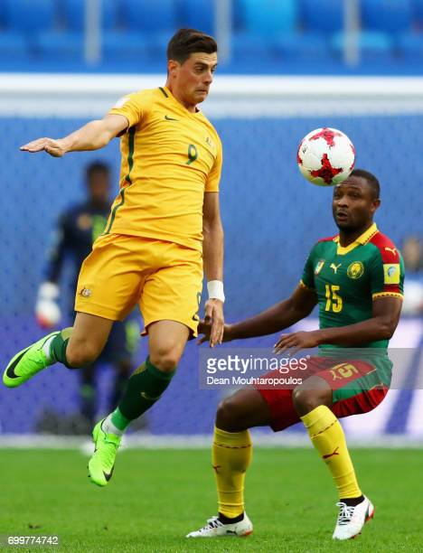 Tomi Juric of Australia wins a header over Sebastien Siani of Cameroon during the FIFA Confederations Cup Russia 2017 Group B match between Cameroon...