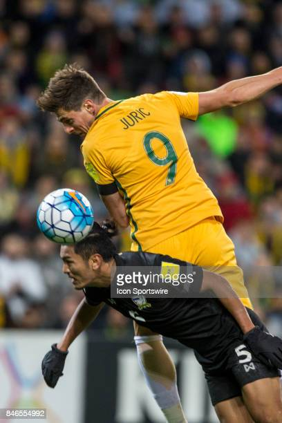 Tomi Juric of the Australian National Football Team and Adisorn Promrak of the Thailand National Football Team contest the ball during the FIFA World...