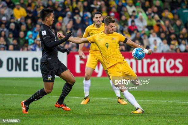 Tomi Juric of the Australian National Football Team attempts a shot on goal in front of Pansa Hemviboon of the Thailand National Football Team during...