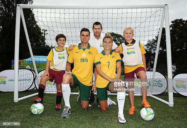 Tomi Juric of the Socceroos former Socceroo Brett Emerton and Steph Catley of the Matildas pose with young soccer players at the launch of MiniRoos...