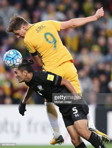Tomi Juric of the Socceroos heads the ball over Goalkeeper Sinthaweechai Hathairattanakool of Thailand during the 2018 FIFA World Cup Qualifier match...