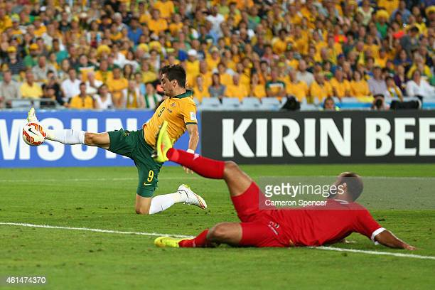 Tomi Juric of the Socceroos scores a goal during the 2015 Asian Cup match between Oman and Australia at ANZ Stadium on January 13 2015 in Sydney...