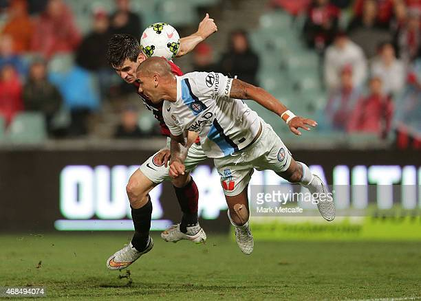 Tomi Juric of the Wanderers and Patrick Kisnorbo of Melbourne compete in the air during the round 24 ALeague match between the Western Sydney...