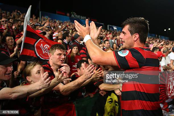 Tomi Juric of the Wanderers celebrates with fans following victory over AlHilal in the Asian Champions League final match between the Western Sydney...