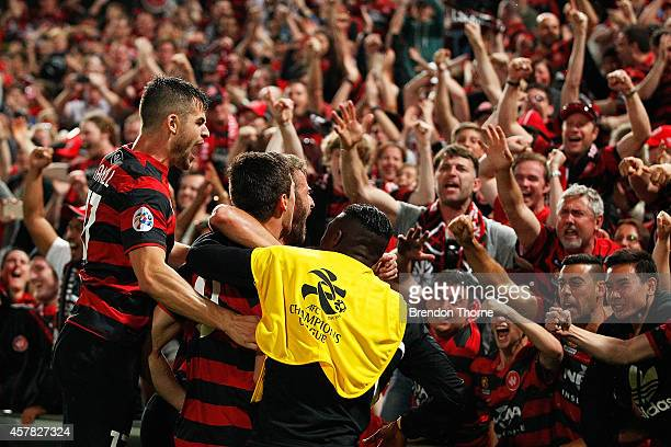 Tomi Juric of the Wanderers celebrates with team mates after scoring a goal during the Asian Champions League final match between the Western Sydney...