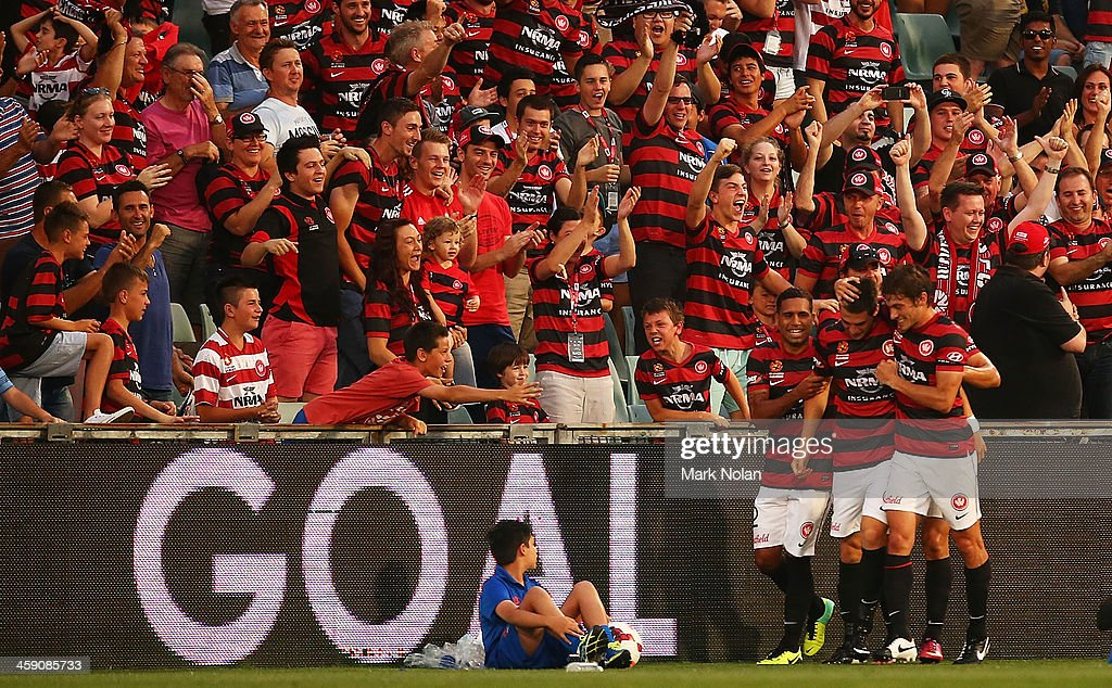 Tomi Juric of the Wanderers celebrates with team mates after scoring during the round 11 A-League match between the Western Sydney Wanderers and the Central Coast Mariners at Parramatta Stadium on December 23, 2013 in Sydney, Australia.