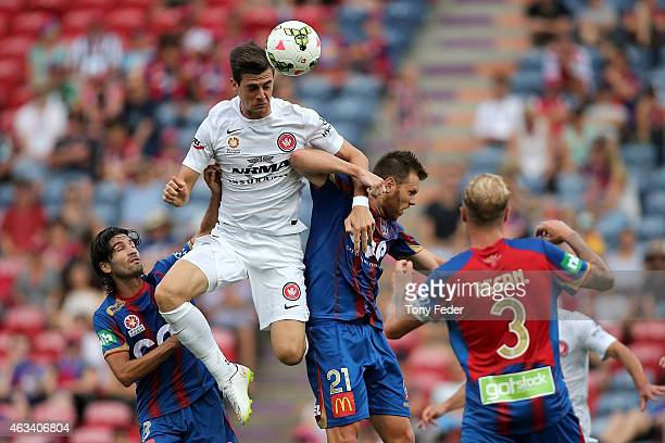 Tomi Juric of the Wanderers heads the ball over Daniel Mullen of the Jets during the round 17 ALeague match between the Newcastle Jets and the...