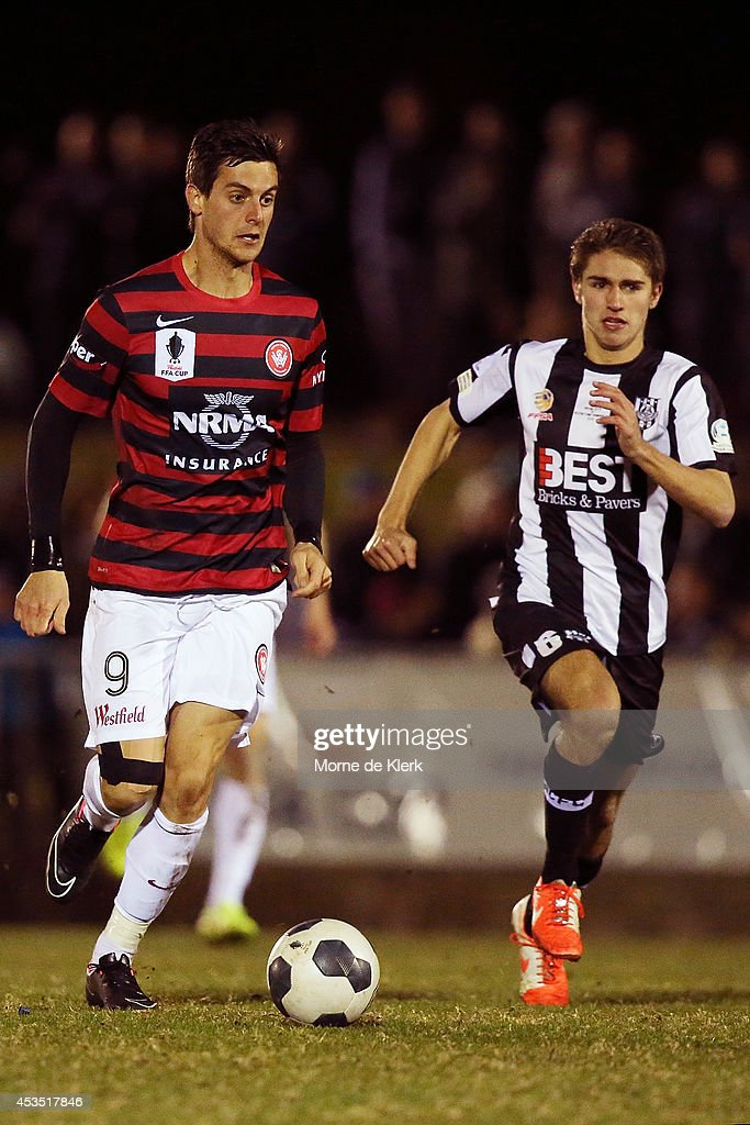 Tomi Juric of Western Sydney runs with the ball during the FFA Cup match between Adelaide City and Western Sydney Wanderers at Marden Sports Complex on August 12, 2014 in Adelaide, Australia.