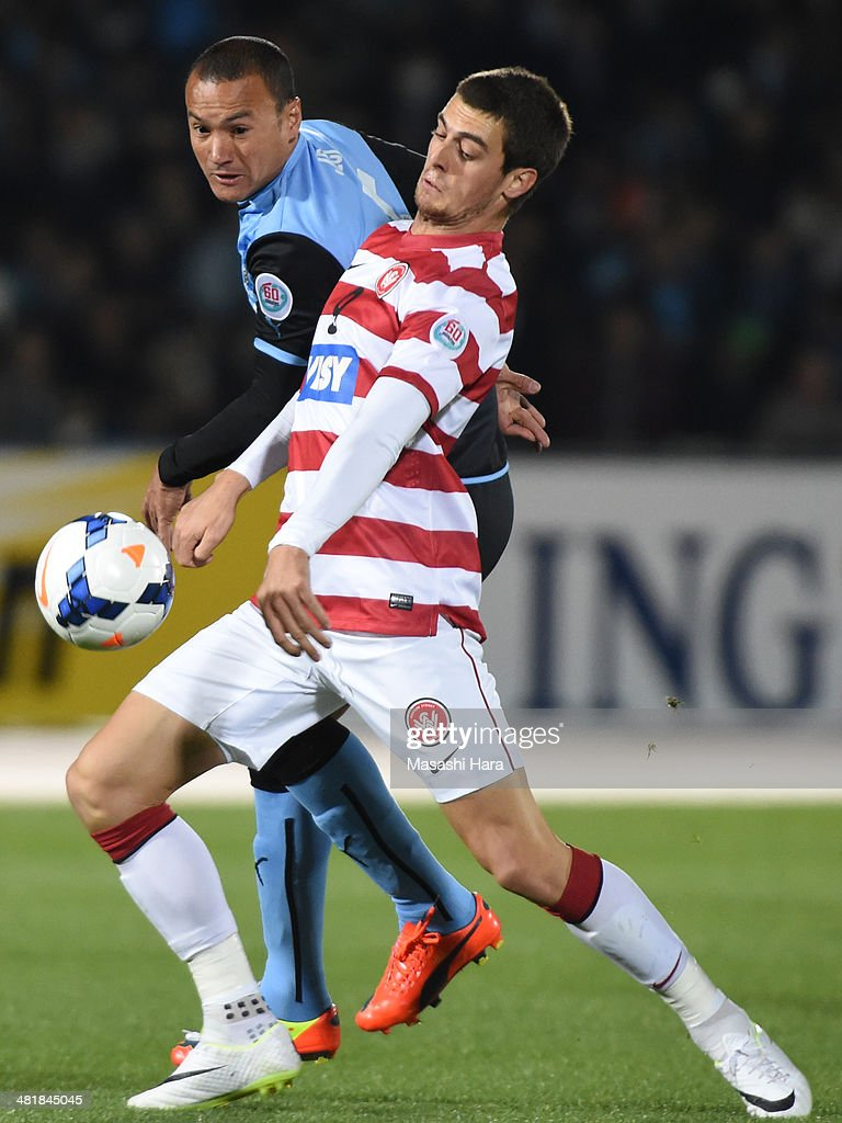 Tomi Juric #9 of Western Sydney Wanderers and Jeci #5 of Kawasaki Frontale compete for the ball during the AFC Champions League Group H match between Kawasaki Frontale and Western Sydney Wanderers at Todoroki Stadium on April 1, 2014 in Kawasaki, Japan.