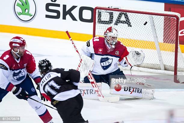 Tomi Kallio of Turku shoot over the goall during the Champions Hockey League Round of 32 match between TPS Turku and IFK Helsinki at Gatorade Center...