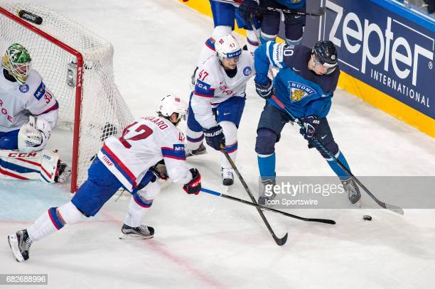 Tomi Sallinen vies with Henrik Odegaard and Alexander Bonsaksen during the Ice Hockey World Championship between Norway and Finland at AccorHotels...