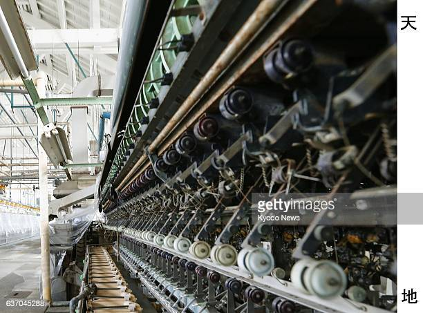 Tomioka Japan One of the Tomioka Silk Mill's wellpreserved automatic silkreeling machines in Tomioka Gunma Prefecture is photographed in October 2013...