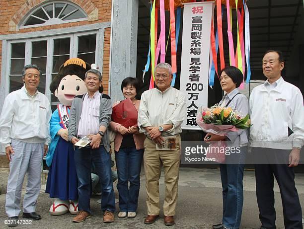 Tomioka Japan Tomioka Silk Mill in Tomioka Gunma Prefecture welcomes 2 millionth visitor Makoto Saito on May 12 2014 The historic factory building is...